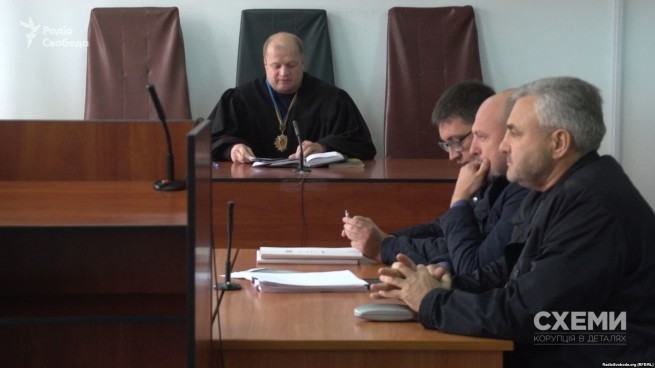 Lazakovych in court with lawyers
